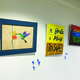"""Three art pieces are displayed during the Old Dome Meeting Hall's """"Not Your Parent's Art Show."""" On the right is a collaborative art piece created by Alexus Powell,12, and Izzy Glass, 12. – Tori La Rue"""