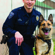 Officer Luis Lovato and his late partner pose together. – www.updk9.org
