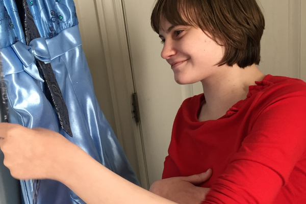 Allie Chandler gazes at the prom dress given to her by Bling It On Dress Rentals. – Katie Chandler