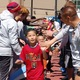 Students at Granger Elementary slap hands with members of the Real Monarchs on April 19 at Granger Elementary. The school's tennis courts will be replaced with Real Salt Lake colored futsal courts this summer. – Mary VanMinde