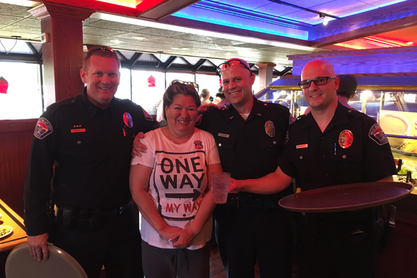 West Valley City police officers stop for a photo during the Cops for Kids event held at Sizzler on Redwood Road on April 21. The officers served patrons for four hours with all proceeds going to the Children's Justice Center. – West Valley City