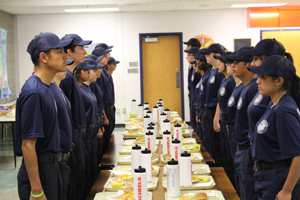 Explorers at the Utah Explorer Academy are to stand at attention until all 58 explorers are served and ready to eat Explorers at the Utah Explorer Academy are to eat in silence at meal time. (Photo: Chris Larson, Sandy City Journal)