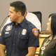 Carlos Lopez had his mother present him with his firefighter badge during the swearing-in ceremony at the Sandy City Council Chambers on June 28, 2016. (Photo: Chris Larson, Sandy City Journal)