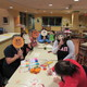 Members of the Alpha Delta Pi Sorority host a craft activity for children.