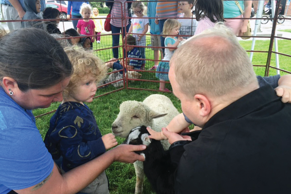 A petting zoo was held in front of the library throughout the day. —Liz Sollis