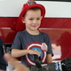 Hudson Wright stands on the bumper of a fire engine in Sandy City Fire Station 31 on June 30, 2016. (Photo: Chris Larson, Sandy City Journal)