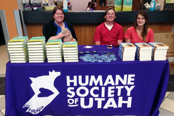 "Jamie Ortwein, Ricardo the cat, Dash Anderson and Savanna Fluter assist at the book signing for Wayne Pacelle's new book, ""The Humane Economy."""