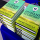 """New York Times bestselling author Wayne Pacelle's new book, """"The Humane Economy,"""" sits ready for signing."""