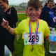 South Jordan Elementary's Chandler Black is all smiles after repeating his win in the cross country distance run during Jordan School District's Sports Day. — Julie Slama
