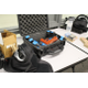 L-R: Sim-gun mask, blue-paneled sim-guns and sim-gun magazines, orange demonstrator gun and boxes of sim-munition in Jordan High School on July 5, 2016. (Photo: Chris Larson, Sandy City Journal)