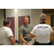 Utah Highway Patrol Trooper Mike Hainey concludes explaining tactics to his squad at Jordan High School on July 5, 2016. (Photo: Chris Larson, Sandy City Journal)