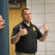 Utah Highway Patrol Sgt. Ben Fallows explains the importance of staying on the same side of the hall when covering an arrest at Jordan High School on July 5, 2016. (Photo: Chris Larson, Sandy City Journal)