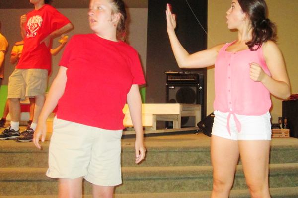 Joseph (right) steps in for a missing cast member during rehearsal.