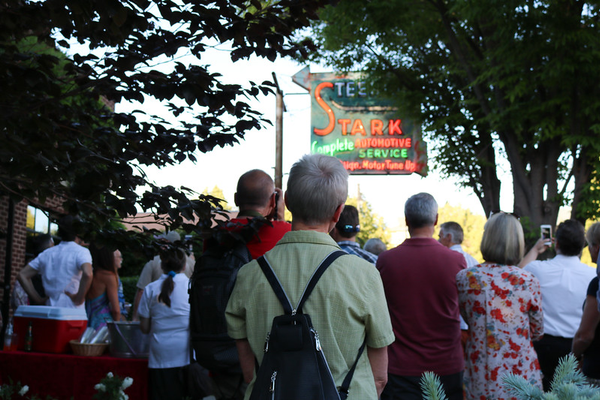 The Stark Steering Sign lights up in front of members of the community to celebrate the restoration of the sign.