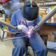Matty Pronovost at Moots lays down sick beads during main frame welding.
