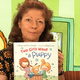 Annie Eastmond reads Two Girls Want a Puppy, written by Ryan and Fiona Fairy and illustrated by Maple Lam during the first episode of Story Time, Salt Lake County Library Service's new virtual story time series. – Salt Lake County Library Services