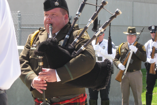 "Sergeant Clyde Glad of the Salt Lake County Sheriff's Office plays ""Amazing Grace"" on the bagpipes to close out the memorial service for fallen officers on May 18. —Travis Barton"