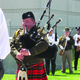 """Sergeant Clyde Glad of the Salt Lake County Sheriff's Office plays """"Amazing Grace"""" on the bagpipes to close out the memorial service for fallen officers on May 18. —Travis Barton"""