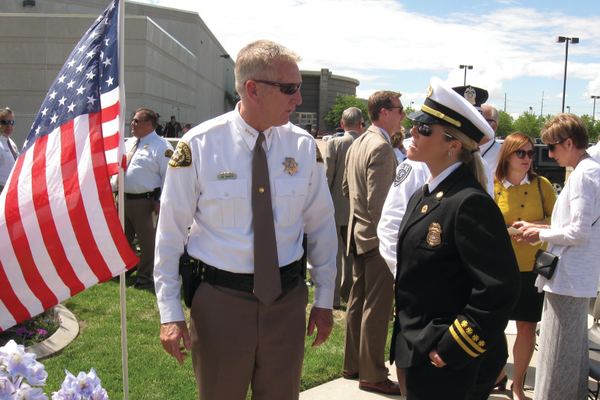 Salt Lake County sheriff James Winder speaks with his wife after the memorial service at the Salt Lake County Sheriff's Office. Winder spoke during the service about the importance of moving on. —Travis Barton