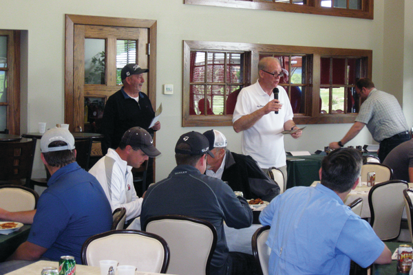 Mayor Ron Bigelow hands out trophies to the winners of the Veteran's Memorial Golf Tournament, held at Stonebridge Golf Course on May 24. All proceeds from the tournament went towards building the Utah Veterans Memorial Museum. —Travis Barton