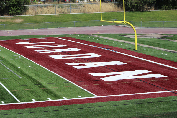 The south endzone after that several alternating layers of sand and rubber crum had bee dumped and spread into the turf of the new Jordan High School turf field, revealing a finished product. (Photo: Chris Larson, Sandy City Journal)