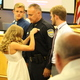 Kalle O'Neal pins her father's, then Capt. Bill O'Neal, deputy chief badge to his uniform at the July 19, 2016 Sandy City Council meeting. (Photo: Chris Larson, Sandy City Journal)