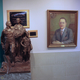 """Near the Draper Elementary principal's office is the bronze statue, """"New Life & New Frontiers,"""" by Utah sculptor Avard Fairbanks. Looking over it is a portrait of Principal Reid Beck, who began the school's art collection in the 1920s. — Julie Slama"""