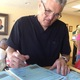 Tom Roberson, a retired firefighter and nurse, fills out a form while volunteering at the Hope Clinic. –Travis Barton