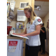Hailey Karg checks a chart while volunteering at the Hope Clinic. –Travis Barton