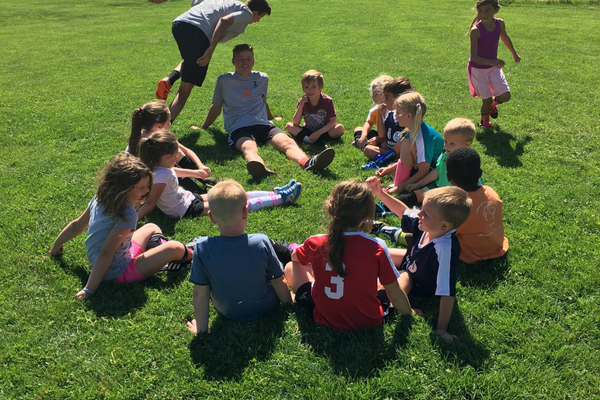 Coaches play games with the kids during the Kicks 4 Cans soccer camp, where the price for entry was non-perishable food items that were later donated to the Utah Food Bank. —Lindsay Christensen