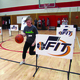 A Riverview Junior High student practices dribbling during the Utah JazzFit program where members of the Jazz dance team, Wheelin' Jazz wheel chair team, stunt team and announcer Steve Brown lead students through stations on May 5 that included shooting, dribbling, dance and strength training. — Julie Slama
