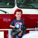 Hudson Wright stands on the bumper of a fire engine at Sandy City Fire Station 31 on June 30, 2016. —Chris Larson
