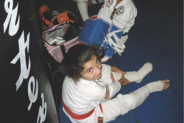 Getting ready to spar – even though she was a higher belt and little, she had to spar the bigger kids.