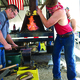 A man gears up to hammer a horseshoe at the World Championship Blacksmith competition at Fort Herriman Days. –Joe Oliver