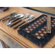Bart and Wendy Kadleck's handmade kitchen tools are displayed on the custom-built table that they made. The Kadleck's began woodworking when Bart was diagnosed with Parkinson's disease and could no longer work as a pilot. – Tori La Rue
