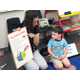Jennifer Adams, preschool teacher, asks Brody Drope, 4, to point to specific letters on a giant poem book. –Tori La Rue