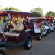 Decorated golf carts ready to start the Battle of the Nines Charity Classic.