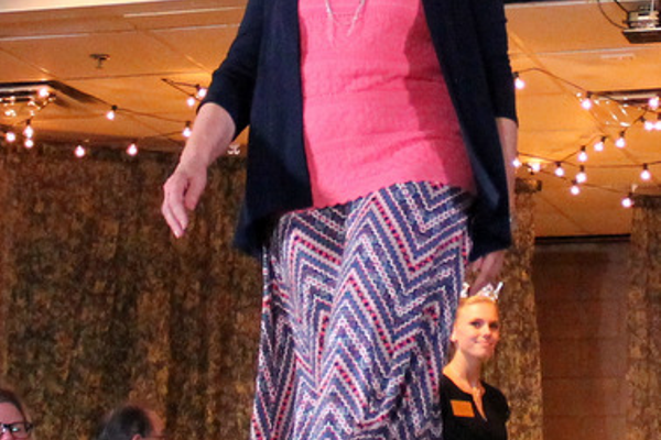 Ann V. models clothes from Dress Barn during the annual Maple Grove Fashion Flair August 18, 2016 at the Maple Grove Community Center. (Photo by Doug Erlien)