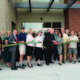 Bluffdale Mayor Derk Timothy and Principal Odila Conica, of the Summit Academy Bluffdale Campus, cut the ceremonial ribbon for the new academy campus on Aug. 15. – Jenny Burgess
