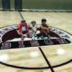 Brooke Gatti's three children sit on the gym's new logo for the Summit Academy Bluffdale Campus during the school's open house on Aug. 15. –Tori La Rue
