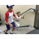 Noah Gatti, 9, and his sister Grace, 5, hold hands as they ran up the stairs to the second level of their new school. –Tori La Rue