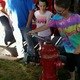 Abbey Pulley, 14, learns how to open a fire hydrant at Taylorsville's Night Out Against Crime. –Tifanie Fitzgerald