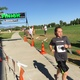 A girl sprints past the finish line at the Taylorsville Triumph Youth and Family Triathlon. –Tori La Rue