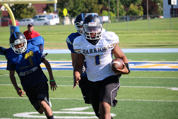 Taylorsville Warriors run the ball during a scrimmage game at Taylorsville High School. –Aryana Apelu