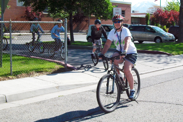 Liberty teacher Judy Mahoskey leads the sixth-grade annual bike ride on bike from the school to a nearby park. She is shown here in 2011. Mahoskey retired this summer after 33 years of teaching students. — Julie Slama