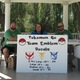Dan Johnson (left), Meghan Bradham and Patrick Johnson sell decals at Murray Park on July 24 as hundreds of people play Pokémon Go around them. –Travis Barton