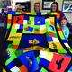 Patricia Donohue, Julie Houtz, April and Tessa Norton show a handmade quilt.  (Jolene Houtz/Resident)