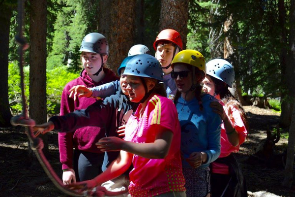 Teens from Utah and Ireland work together to get through a high ropes course during Utah Ulster Project 2016. The project aims at building relationships despite differences. -- Utah Ulster Project