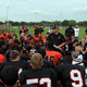 Head Coach Ryan Stockhaus addresses the Osseo football program on OFA Showcase Friday Photo ByDoug Erlien