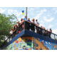 Local artist Roger Whiting, along with West Valley City interns and kids, painted a mural along a blank wall at West View Park. –Travis Barton